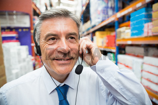 Warehouse manager giving orders on headset