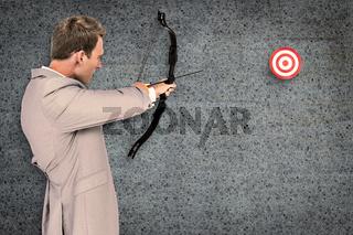 Composite image of businessman shooting target