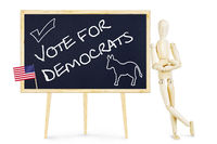 Propagandist calls on vote for Democrats in US elections. Abstract image with a wooden puppet