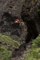 Emergency services helicopter rescueing an injured walker in the Masca barranco
