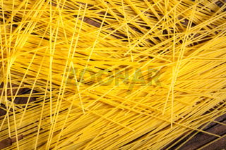 italian spaghetti on wooden background
