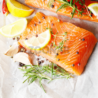 Raw salmon on baking paper
