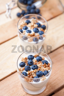 Nutritious and healthy bio yoghurt with blueberries and cereal