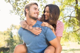 Cute couple having fun in park