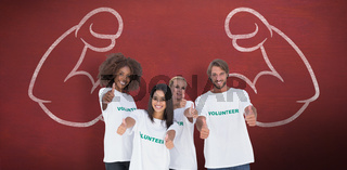 Composite image of happy group of volunteers giving thumbs up