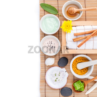 Natural Spa Ingredients sea salt ,sage ,honey , aloe vera ,spa stones and white mortar on wooden background for scrub and skin care.