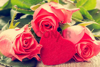 Pink roses and handmaded toy heart