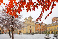 City square under snow. Alba, Italy.