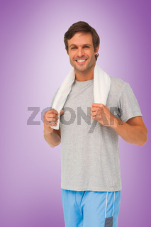 Composite image of portrait of a fit young man with towel