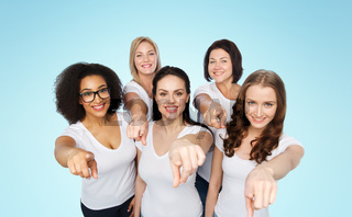 group of happy women pointing finger on you