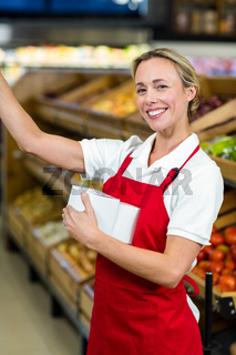 Smiling seller holding white plastic bag