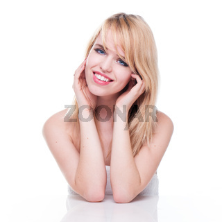 Smiling Young Blond Woman with Head in Hands