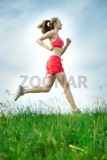 Young woman running summer park rural road. Outdoor exercises.