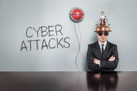 Cyber attacks text with alert light and vintage businessman