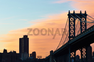 Manhattan Bridge and skyline silhouette view from Brooklyn at sunset