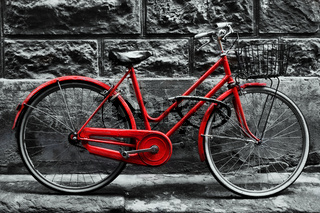 Retro vintage red bike on black and white wall.