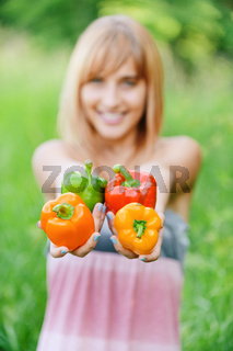 Beautiful girl with sweet pepper