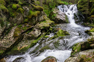 waterfall in deep forest at mountains