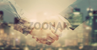 Double exposure of business people handshake on big city background