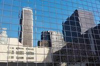 Skyscraper reflection in glass windows