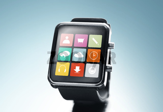 close up of black smart watch with app icons