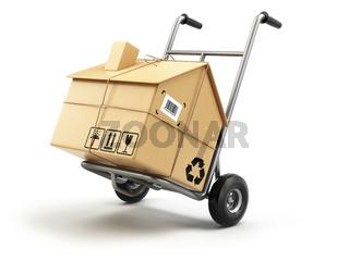 Hand truck with cardboard box as home isolated on white. Delivery or moving house concept.