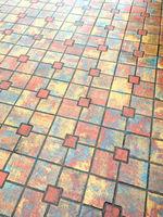 wet colored urban sidewalk
