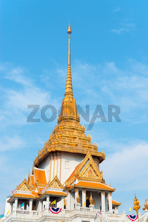 Ornate Roof and Spire of Wat Traimit in Bangkok, Thailand