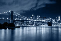Brooklyn Bridge in New York with lights reflections on water