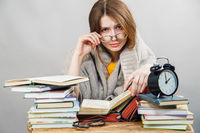 girl student with glasses reading books