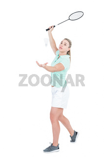 Pretty blonde playing badminton