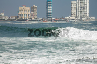 Man surfing on a wave in Iquique Chile.