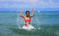 Girl splashing seawater