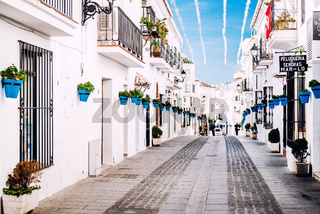 Mijas, Spain- January 05, 2014: Charming whitewashed street In Mijas. Mijas is a lovely Andalusian white village on the Costa del Sol. Spain
