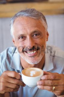 Man sitting in cafe having coffee