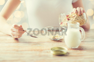 close up of woman eating muesli for breakfast