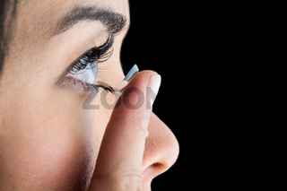 Woman about to insert her contact lens