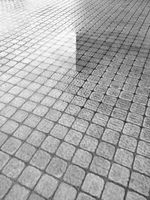 wet gray concrete brick pavement