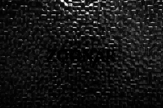 Black tile wall background reflecting light. Elegant pattern