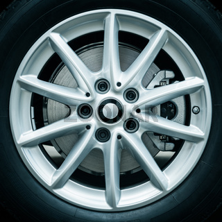 Details of modern and luxury aluminium car wheel with tire