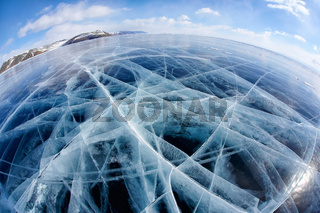 Winter ice landscape on Siberian lake Baikal with clouds