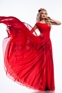 woman in red dress on white background