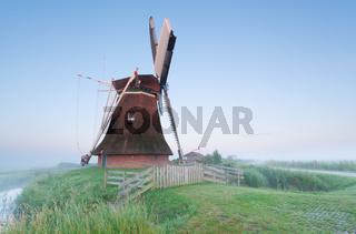Dutch windmill in misty morning