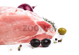 piece raw meat with decor from on side
