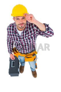 Smiling handyman with tool box