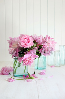 Pink peonies in glass jars