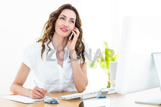 Smiling businesswoman having phone call
