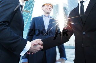 Investor and contractor shaking hands