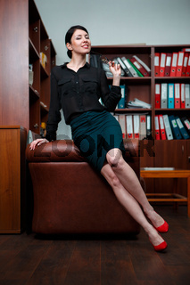 Woman with flirting pose in office.