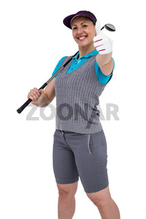 Golf player posing with golf club